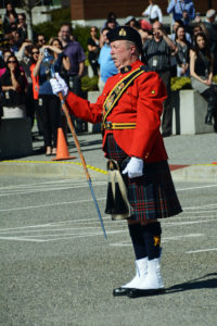 2016-03-31 RCMP Drum Major bringing the Pipes and Drums to a halt at the new mace ceremony, Surrey BC (77)