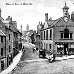 "Church Street, Brechin, post card circa 1905. Colin Stevens' Collection (Purchased 2003). The ""Unionist Club"" / ""W S LOW & COMPANY"" (grocer apparently) and A. Belford, Baker. Another example of this card was postally used in 1909. Published by Valentine. The building with the clock is now the City's Museum. The clock was still there in 2005."