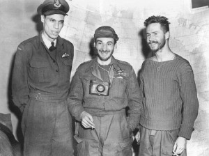 Three military men standing in a group.