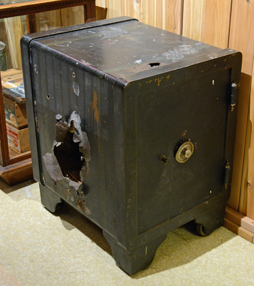 Safe with large hole blown in the left side. At the Cumberland Museum which had been blown open by safecrackers. A fascinating story which the museum has lost completely. Shown in  September, 2013.