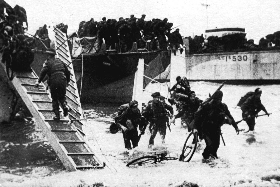 BSA Airborne Bicycle in the surf being dragged ashore on D-Day, June 6, 1944. The thoughts of this soldier or Marine are certainly not fit for young ears!