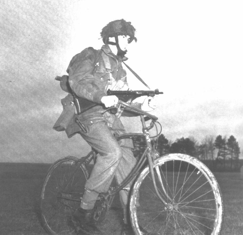 Canadian paratrooper on a BSA airborne bicycle 1944, in England.