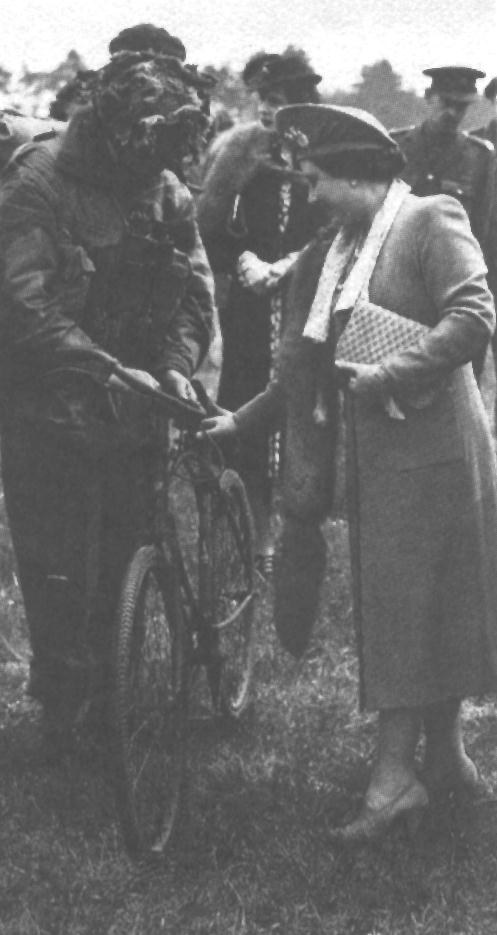 The Queen examining a BSA Airborne Bicycle, probably in May 1944.