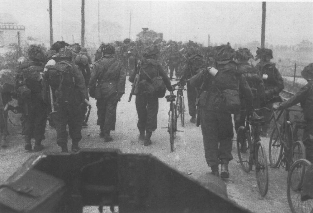 BSA Airborne Bicycles in being walked by 2nd Battalion East Yorkshire_to Collevlle-sur-Mer in Normandy. D-Day, June 6, 1944.