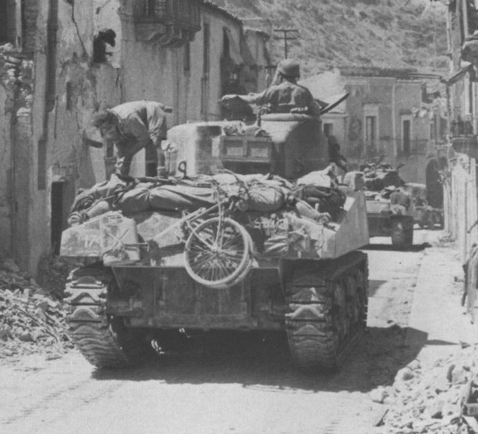 BSA Airborne Bicycle on the back of a Sherman tank of the Canadian 3 Rivers Regiment at Regalbuto, Sicily in 1943. It is obviously being carried for running errands etc. once that tank is in a hide.