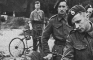 Royal Marine Commandos in Southern England immediately before D-Day, June 1944. They have BSA Airborne Bicycles with the Everest Carrier fitted to the front. They are having a kit inspection, so the loaded rucksack, rope etc. is not loaded onto the bicycles. A bicycle tool pouch, likely off of a rigid Mark IV bicycle, is visible on a bicycle in the background.(DETAIL)