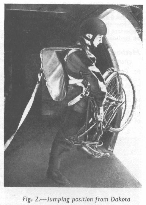 BSA Airborne Bicycle in the folded position for parachuting with a man. After his parachute opens, he will lower the bicycle about 20 feet below him. (Royal Air Force Manual)