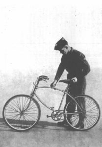 Solider tightening, or loosening, the upper butterfly nut that holds the bike open for riding. (from RAF Airborne Forces manual)