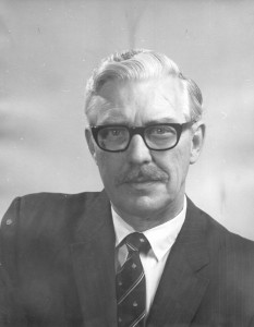 Photograph of head and shoulders of Dr A.H. Stevens circa 1975