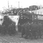 Highland Light Infantry Regiment loading onto landing ships with their BSA Airborne Bicycles (Canadian Army Photo - Library and Archives Canada PA132812)