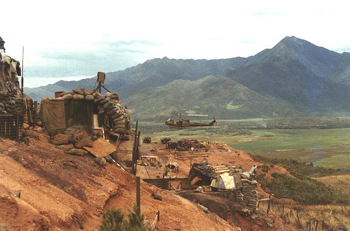 Huey_landing_hillside_compound_mor_pit