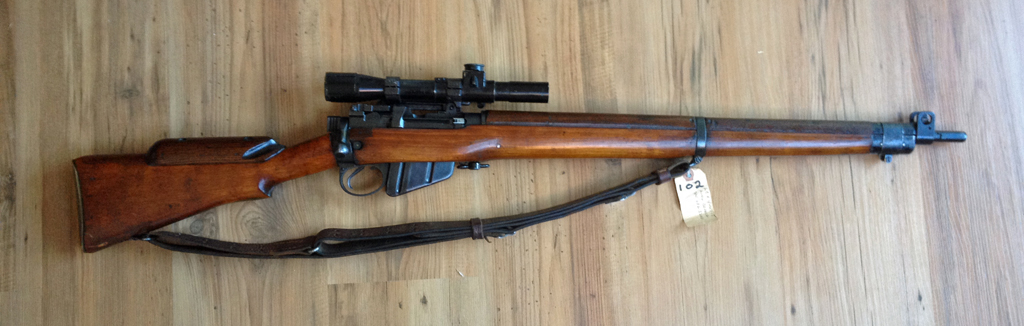 No.4 MK. I* (T) sniper rifle mae by SAL at Long Branch in Canada. Serial number 68L3200. This one has the Ishapore screw which was a typical Indian military modification. Right side of whole rifle shown. The scope shown is a mismatched original No. 32 MK. II scope.