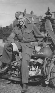WWII Canadian Army officer leaning against his mopotorcycle. Lieutenant A. H. (Pete) STEVENS Lincoln and Welland Regiment. 1942 in Newfoundland with his new Harley-Davidson WLC motorcycle DND number 42-1-5561