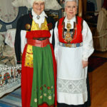 Two ladies in Scandinavian folk cotumes.