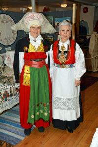 Two ladies in Scandinavian folk cotumes.