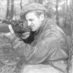 British WWII Sniper aiming his rifle.