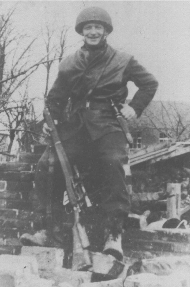 "1 Canadian Parachute Battalion sniper Pte. R. C. Rushton Roermond, Holland 1945. He has a ""Killing Knife"" on his left hip. It is an all-black version of the USMC Stiletto. (Out of the Clouds)"