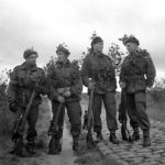 1944-10-09 Approximate date. Queen's Own Cameron Highlanders of Canada. This group of snipers killed 101 enemy up to that date. Cpl. G.E. Mallery; Pte. J. Gray; Cpl B. B. Arnold; Sgt. P. A. Rylaasden (L&AC ________________)