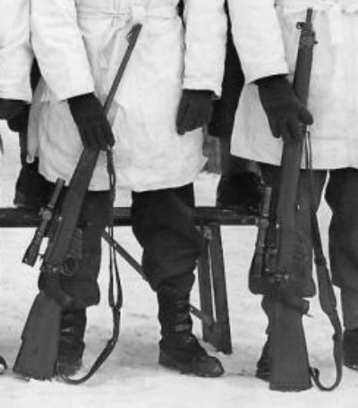 DETAIL showing two different model Lee-Enfield No. 4 sniper rifles - 1945-01-12 Third Snipers' Course at Camp Borden, Ontario, Canada. Note the variety of No. 4 (T) rifles. (Private collection)