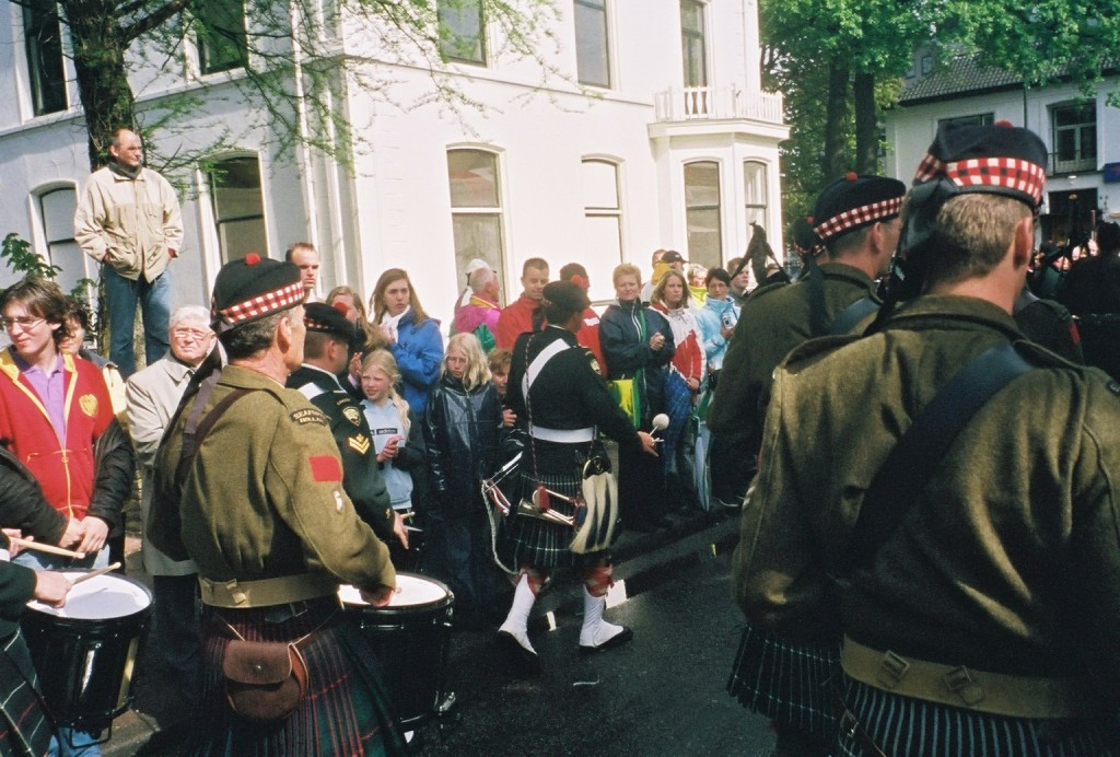 Apeldoorn 2005 - Seaforth Highlanders of Canada Pipes and Drums with Seaforth Highlanders of Holland in battledress mixed in with them