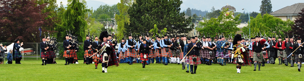 Massed pipe bands at Victoria Highland Games