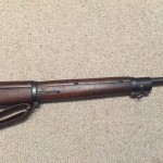 A late 1943 M1903A4 serial number 3422193. This rifle is original with the blued finish but the M73B1 scope has been refurbished by the military. - Right side of front section of rifle.