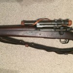 A late 1943 M1903A4 serial number 3422193. This rifle is original with the blued finish but the M73B1 scope has been refurbished by the military. - Left side of centre section of rifle.