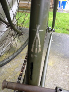 "British Army BSA airborne bicycle, 2nd model, made circa 1943 serial number R37618 - Detail of decal (transfer) on seat tube. BSA piled rifles ""TRADE MARK"" and letters BSA underneath. These have been seen in silver as well as in gold colour."