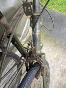 British Army BSA airborne bicycle, 2nd model, made circa 1943 serial number R37618 - folded position showing detail of front brake and decals (transfers).