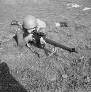 British soldier aiming his rifle.