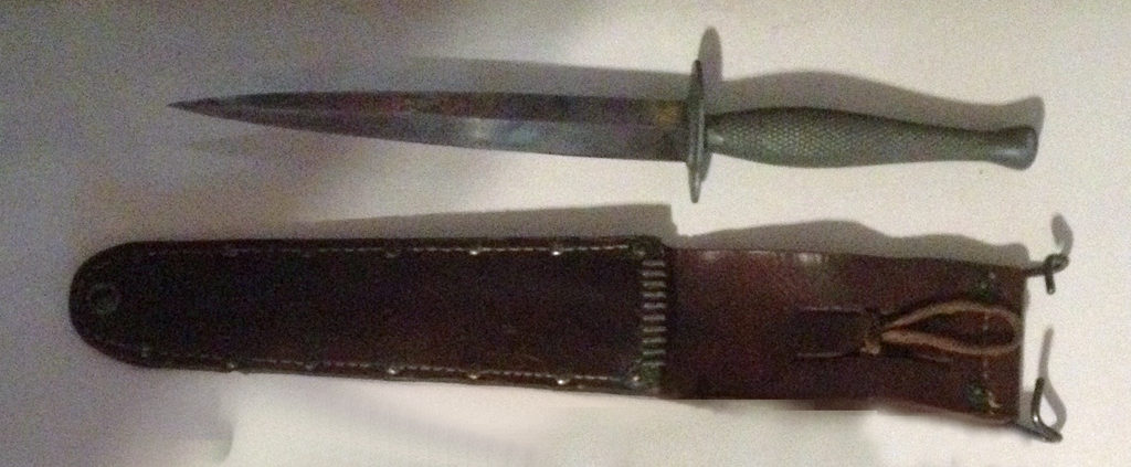 USMC Stiletto, with no markings remaining visible, with staples at throat of scabbard. Snap fastener strap is gone and the Marine fitted a leather lace loop fitted to retain the knife. Formerly in the Colin M. Stevens Collection.