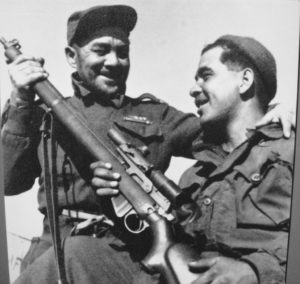 """""""Pop"""" Wheeler (left) from the Pioneer Platoon of 1 PPCLI and his son Jake Wheeler, sniper in Sloppy Sam's Sniper Section. Jake has a Canadian made No. 4 MK. I* (T) with C No. 67 MK. I scope. Korea, 1952 by Paul E. Tomelin (L&AC PA 128844 MIKAN 3397766)"""