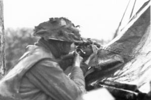 Looking at a British sniper from behind.