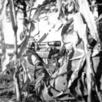 Canadian sniper in a cornfield. Location and date unknown. by Lt Ken Bell L&AC PA 211728