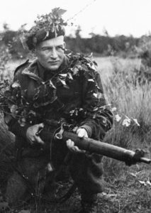 1933-10-09 ? A sniper of the Scout Platoon, Queen's Own Cameron Highlanders of Canada at Brasschaat, Belgium. DND photo (ref. The Lion Rampant p. 72)