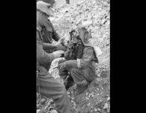 Sniper school Normandy 27 JUL 44 applying camouflage face paint © IWM (B 8174)