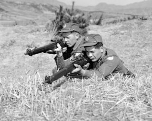 Two Canadian snipers in Korea. The one on our left has a Canadian made No. 4 MK.I* (T) with a Canadian R.E.L. made C No. 67 MK. I scope. The man on the right has a Canadian made No. 4 MK. I*(T) Trade Pattern with U.S. made Alaskan No. 32 TP MK. I scope.