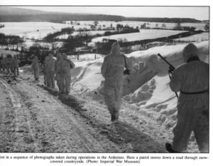 1945 JAN 14 - British 6th Airborne Division fighting patrol which includes a young sniper. Ardennes.