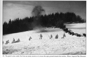 1945 JAN 14 - British 6th Airborne Division fighting patrol which includes a young sniper. Ardennes. Coming under enemy mortar fire.