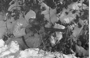 British 6th Airborne Division combat patrol. Sniper. His magazine is not seated properly and is ready to fall out.