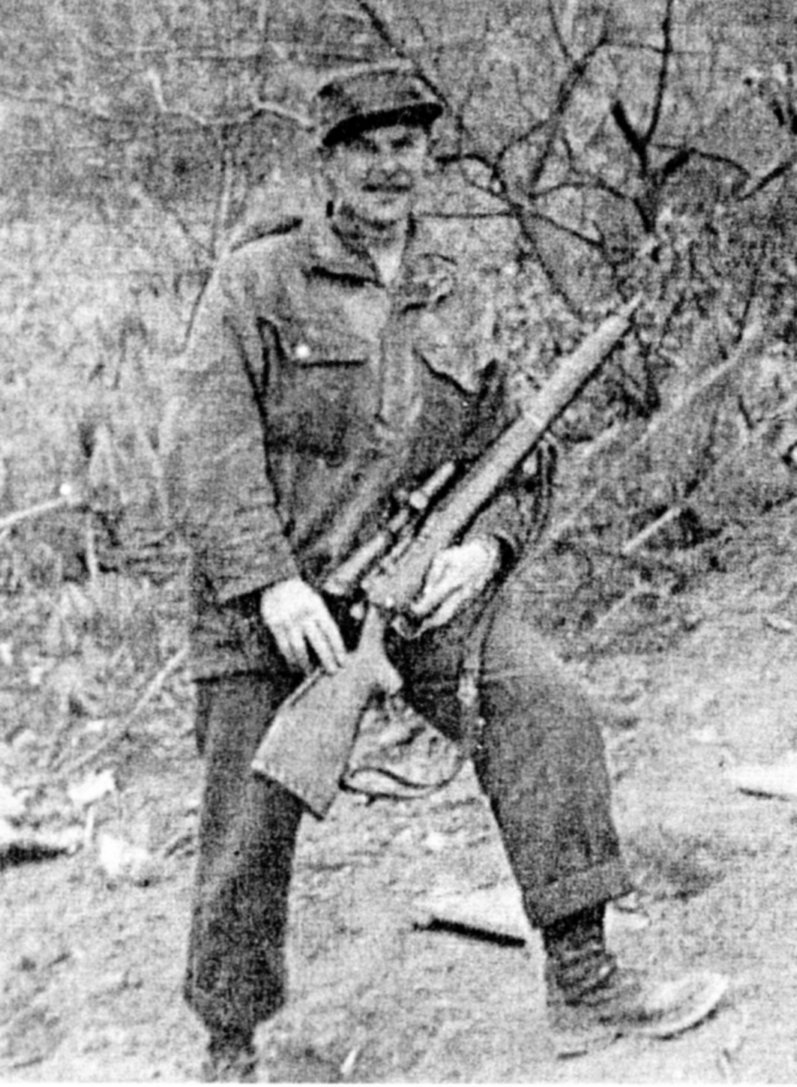 Canadian soldier holding his sniper rifle.