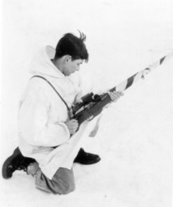 Canadian sniper with his camouflaged Ross MK. III with a Model 1913 Warner Swasey scope. He has the bolt pulled back ready to push it forward to load the rifle. This was during Winter training. (MilArt Photo Archives)
