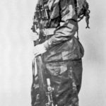 Harry Furness, a British sniper late in WWII . He has his No. 4 MK. I (T) and is wearing a British two-piece windproof camouflage suit. (OON p245)