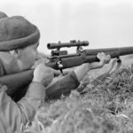 Sniper in training with a No. 3 MK. I (T) sniper rifle.
