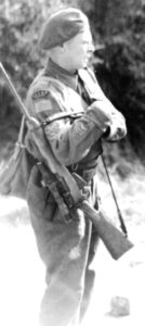 RCEME soldier with a cut-down No. 4 MK. I (T) or No. 4 MK. I* (T). Some people thought it was an Experimental Scout sniper rifle but others do not accept this. (National Archives)