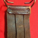 USMC Stiletto scabbard - back view of top showing the M1910 belt hook and belt slots. The two prongs of the rivet for the retaining strap are also visible. - Colin M Stevens' Collection