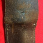 USMC Stiletto scabbard - back view of centre. The two holes of prongs of a rivet for a low retaining strap are also visible. - Colin M Stevens' Collection