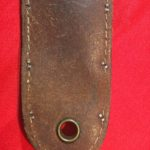 USMC Stiletto back of the scabbard showing the large grommet. . - Colin M Stevens' Collection