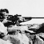 British sniper aiming his rifle.
