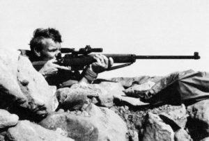 British sniper aiming his rifle.